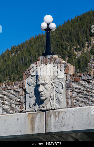 Detail of the First Nation relief on the 1921 Bow River bridge in Banff National Park, Alberta, Canada. Bridge designed - Stock Photo