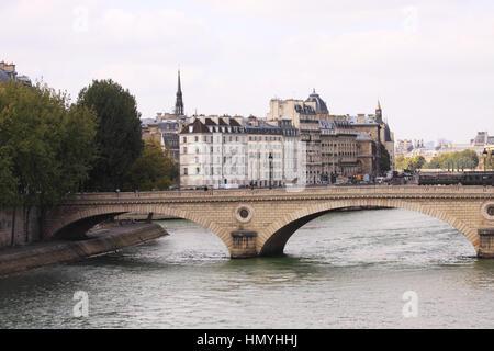 Pont Louis-Philippe crossing over River Seine in Paris - Stock Photo