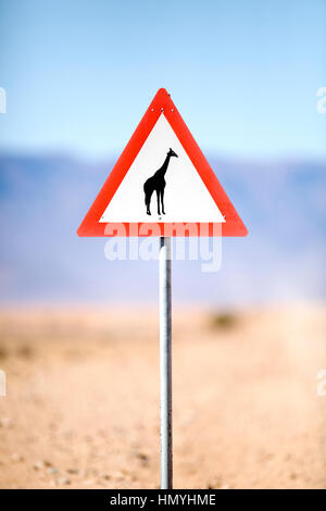 Caution sign in the Namibian desert - Stock Photo