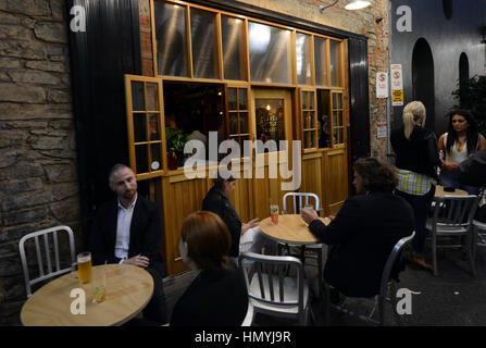 Friday night drinks at the trendy Clever Little Tailor bar in Adelaide. - Stock Photo
