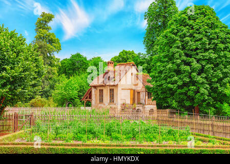 VERSAILLES, FRANCE - JULY 02, 2016 : Landscape of hamlet Queen Marie Antoinette's estate near Versailles Palace. - Stock Photo
