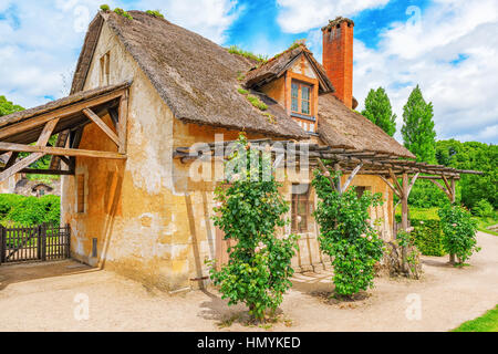 VERSAILLES, FRANCE- JULY 02, 2016 : Landscape of hamlet Queen Marie Antoinette's estate near Versailles Palace. - Stock Photo