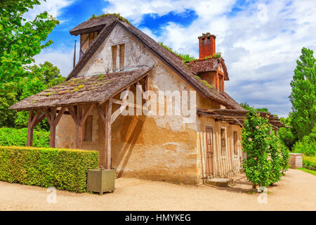 VERSAILLES, FRANCE - JULY 02, 2016 :Landscape of hamlet Queen Marie Antoinette's estate near Versailles Palace. - Stock Photo