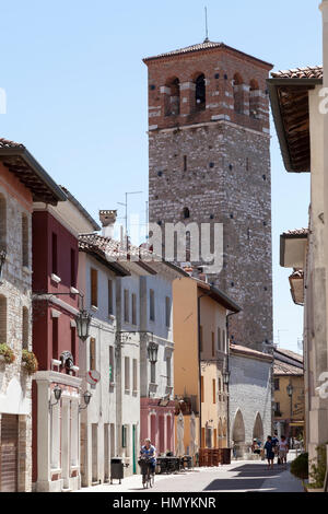 Old tower in the main course of Marano Lagunare - Stock Photo