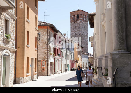 The main street of the old town of Marano Lagunare - Stock Photo