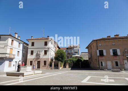 Square with ancient well, Marano Lagunare - Stock Photo