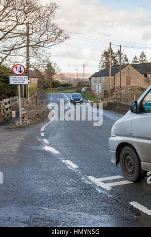 Give way to oncoming vehicles road sign. Give way sign at a narrow bridge, Brough, Derbyshire, England,UK - Stock Photo