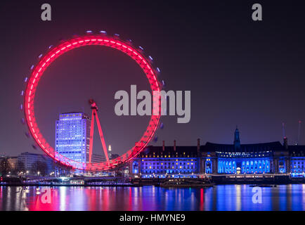 London Eye wheel on River Thames at night - Stock Photo
