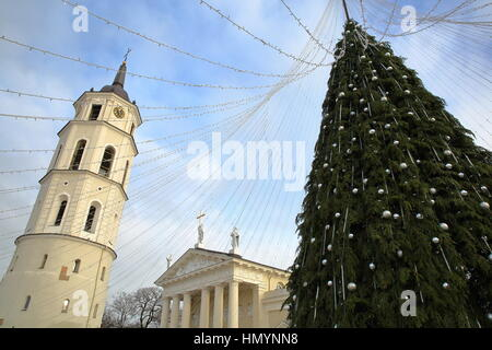 VILNIUS, LITHUANIA: The Belfry (Cathedral Clock Tower) and a Christmas tree  on Cathedral Square with the Cathedral - Stock Photo