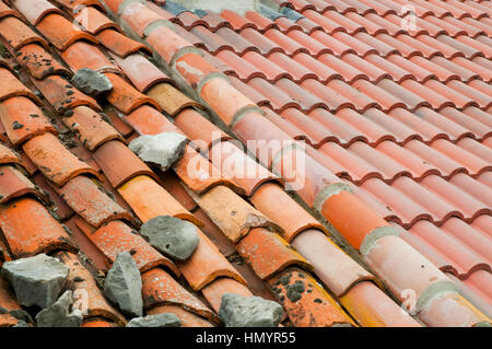 Old tiled roof and new tiled roof.rooftop - Stock Photo
