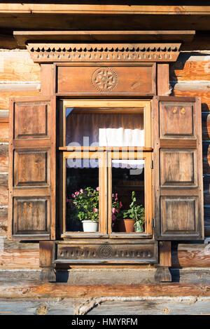 Suzdal, Russia - November 06, 2015 Beautiful window of Museum Wooden Architecture - Stock Photo