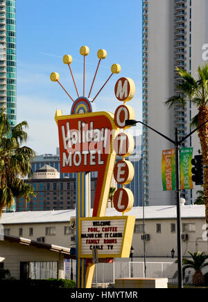 Vintage Holiday Motel Sign in Downtown Las Vegas - Stock Photo