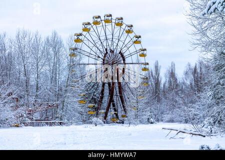 Winter view of children's entertainment attraction in Pripyat. Chernobyl, Ukraine. - Stock Photo