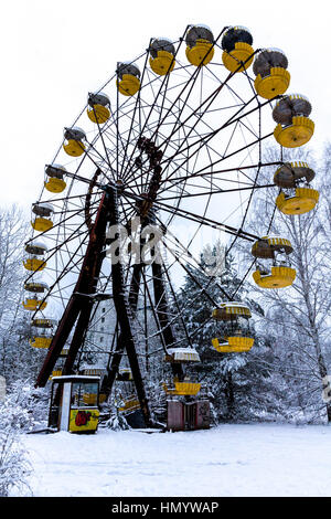 Winter view of children's entertainment attraction in Pripyat. Chernobyl, Ukraine. - Stock Photo