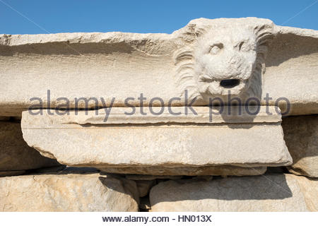 Carved stone with the head of a lion at the Delos archaeological ruins in Greece. - Stock Photo