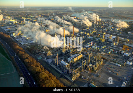 Chempark Dormagen with steaming chimneys in the morning light, production, research and services companies, chemical - Stock Photo