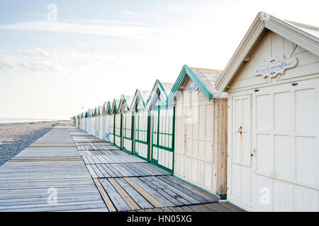 Cayeux-sur-Mer (France), shingle beach and alignement beach huts - Stock Photo