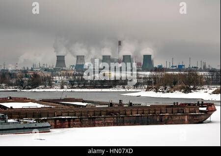 Steam and smoke from the chimneys and cooling towers city Central Heating and Power Plant