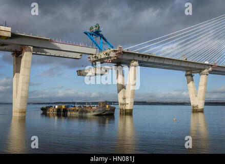Raising the last section of the new Queensferry Crossing over the River Forth, February 2017 - Stock Photo