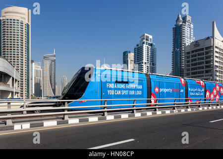 DUBAI, UAE - DEC 5, 2016: Modern trolley car at the new tram service in the city of Dubai. United Arab Emirates, - Stock Photo