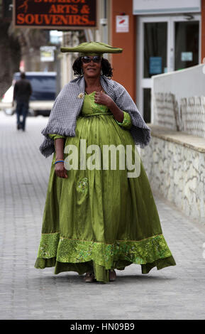Herero woman wearing traditional dress at Swakopmund in Namibia - Stock Photo