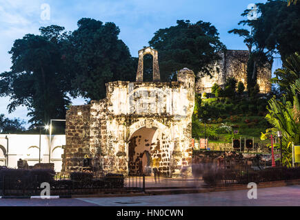 Gate of the colonial fortress and the ruined of the Saint Paul church in the background in Melaka (Malacca) colonial - Stock Photo