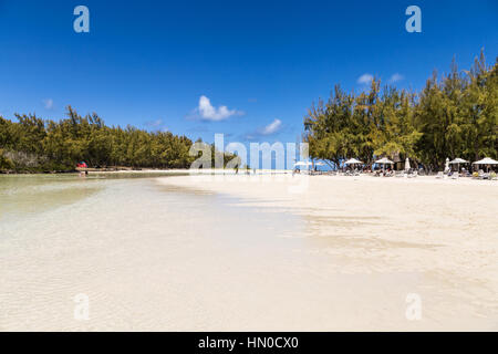 Idyllic beach on ile aux cerfs (deer island) off the coast of Mauritius. This is a popular day trip for tourists - Stock Photo