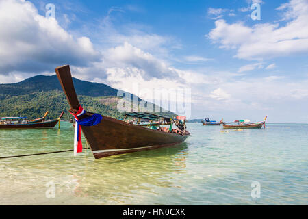 A low angle view of a traditional long tail on a beach in Koh Lipe island in the Andaman sea in south Thailand in - Stock Photo