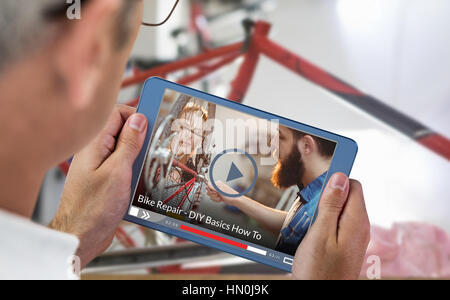 Fast forward sign on digitally generated blank screen against man using digital tablet and smart phone at table - Stock Photo