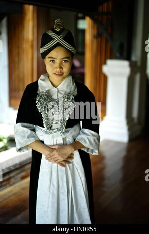 Young girl wearing a Hmong Kao traditional dress in Laos. Name: Anna Saksena