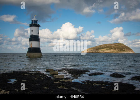 Penmon Lighthouse and Puffin Island at Penmon Point, Anglesey, North Wales - Stock Photo