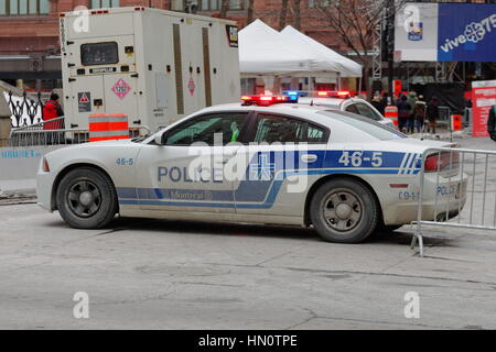 A city of Montreal police car blocking a street during an outdoor event. - Stock Photo