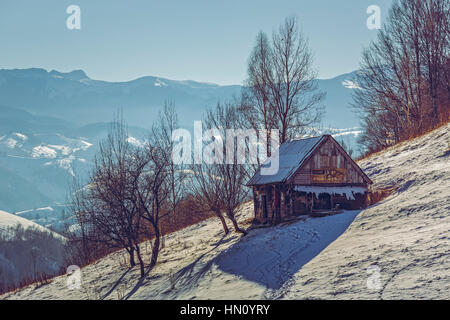 Deserted weathered wooden ramshackle. Winter rural landscape with old rustic wooden cowshed in Pestera village, - Stock Photo