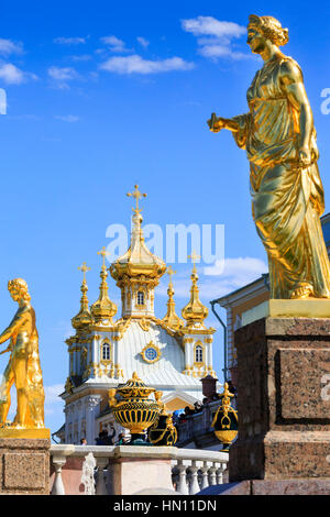 Gold statues and fountains of the grand cascade, Peterhof, St Petersburg, Russia - Stock Photo