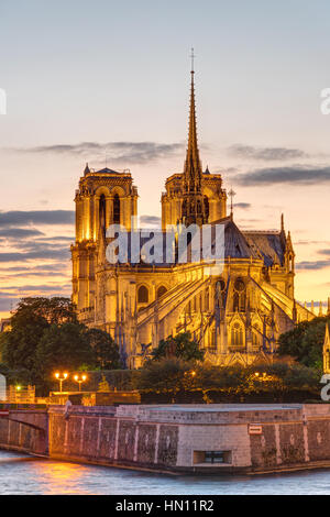 The Cathedral of Notre Dame in Paris at sunset - Stock Photo