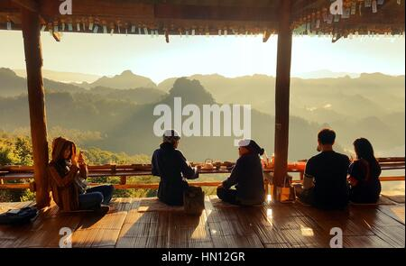 November26, 2016 - Mae Hong Son, THAILAND : People relaxing and enjoying sunrise at view point in the noodle shop - Stock Photo