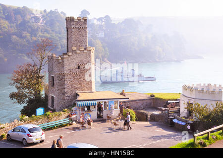Dartmouth Castle and Tea Rooms with a passing naval ship on the River Dart estuary, South Hams, Devon, England, - Stock Photo