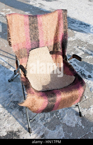 ... Old, Used Aluminum Metal Chair In The Open Air On A Snow Covered Stone  Pavement