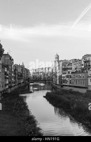 Onyar river crossing the downtown of Girona with bell tower of gothic Cathedral of Saint Mary in background. Gerona, Costa Brava, Catalonia, Spain. Mo