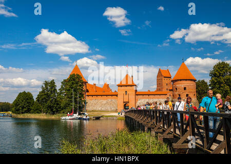 TRAKAI, LITHUANIA - 22 AUG 2015: Tourists visit Trakai castle in sunny siummer day - Stock Photo