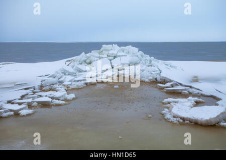 Ice on Baltic sea, cloudy day - Stock Photo