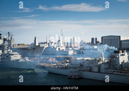 British Navy ships tied up in Portsmouth Harbour navy base - Stock Photo