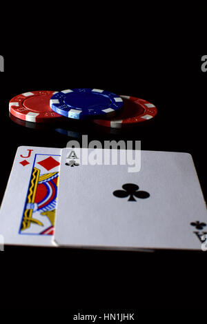 Blackjack. Playing cards ace and jack and betting chips on the table. - Stock Photo