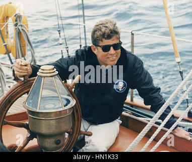 JOHN F. KENNEDY (1917-1963) at the wheel of a US Coastguard yacht while on holiday in Maine on 12 August 1962 - Stock Photo
