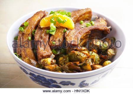 Szechuan barbecue beef ribs with roasted brusell sprouts - Stock Photo