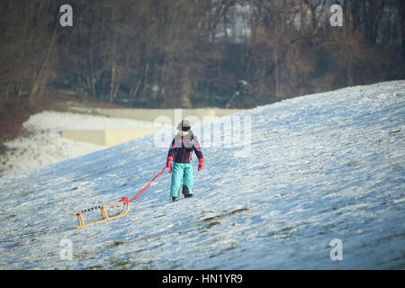 ZAGREB, CROATIA - JANUARY 15, 2017 : A boy pulling the sledge up the hill at winter time in Zagreb, Croatia. - Stock Photo