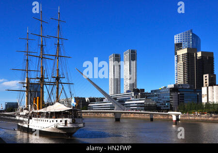 Buque Museo Fragata Sarmiento and Puente de la Mujer on beautiful day in Puerto Madero District of Buenos Aires, - Stock Photo