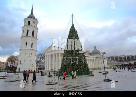 VILNIUS, LITHUANIA - JANUARY 2, 2017: The Belfry (Cathedral Clock Tower) and a Christmas tree on Cathedral Square - Stock Photo