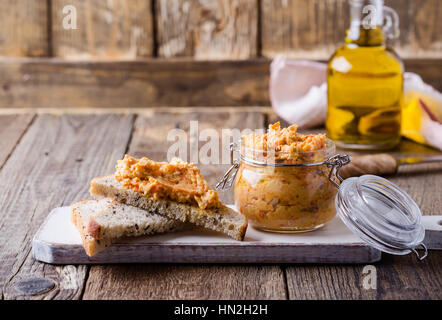Homemade bean paste, Sandwiches with vegan pate on whole wheat bread. Dip of white beans in glass jar on rustic - Stock Photo