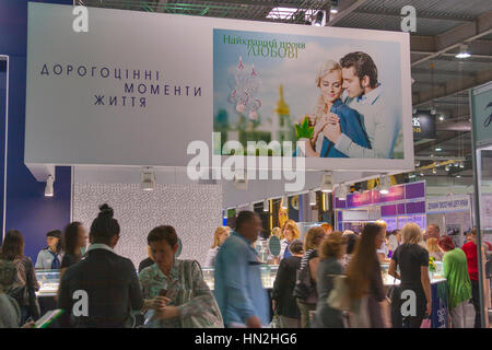 KIEV, UKRAINE - MAY 16: Visitors visit Kyiv Jewelry Factory (founded 1936) booth during Spring Jeweller Expo exhibition - Stock Photo